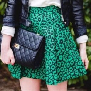 Green cheetah print pleat mini skirt